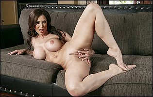 Kendra Lust teasing with hot naked body on couch