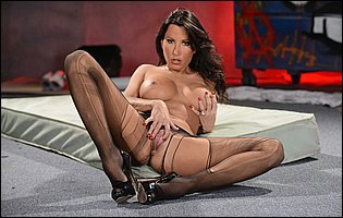 Lezley Zen in black pantyhose and high heels showing off pink twat