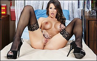 Kortney Kane takes off her sexy underwear and poses in black stockings and high heels