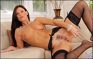 India Summer in black nylons fucks her cunt with a glass dildo