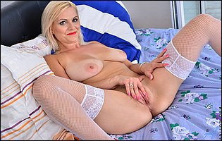 Kirsten Klark in white stockings and red heels likes teasing