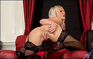 Gorgeous mature lady in black stockings playing with her bald cunt