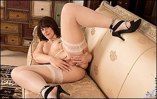 Toni Lace in sexy nylons and panties plays with her pussy