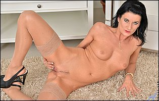 Hot brunette Celine Noirte in sexy nylons loves showing her tight body