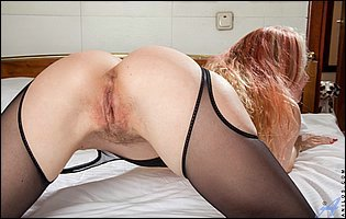 Foxy Love in black nylons poses and touches herself