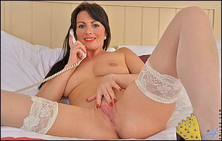 Roxanne in white nylons sensually touches herself