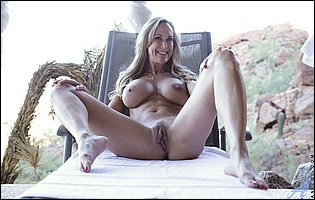Brandi Love teasing with amazing nude body outdoor