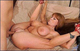 Mature redhead Darla Crane gets big cock in her tight twat