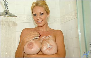 Gorgeous busty MILF Charlee Chase takes a shower