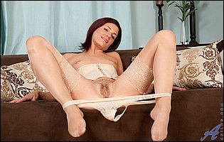 Sofia Matthews in sexy lingerie and nylons showing off pussy and playing with dildo