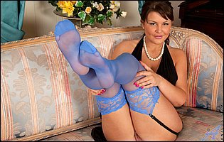 Elle Brook in blue nylons teasing