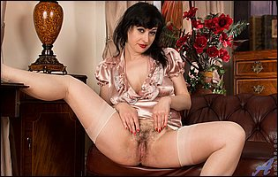 Nikita in sexy nylons spreads her legs and hairy cunt