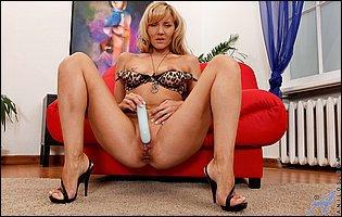 Sexy blonde Zlata dildoing her tight bald twat