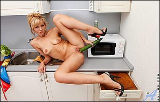 Zlata fucks her cunt with a cucumber in the kitchen