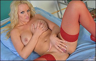 Frankie in sexy red stockings touches her pussy