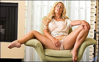 Cherie Deville in sexy top and panties sensually touches herself