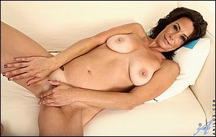 Mature brunette Mimi Moore teasing with naked body