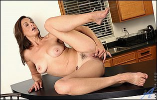 Mimi Moore getting naked and teasing in the kitchen