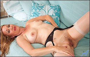 Gorgeous mature blonde Camilla in sexy lingerie and nylons showing her body