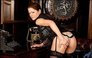 Elegant lady Miah Croft in black lingerie and stockings loves teasing