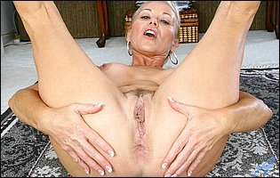 Hot mature blonde Veronica getting naked and playing with her pussy in kitchen
