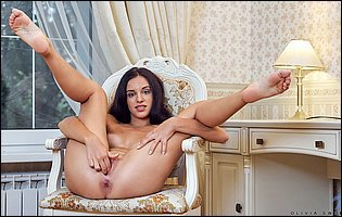 Olivia Sweet spreads legs and fingering her vagina