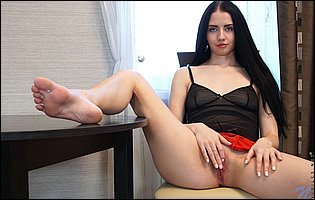 Veronica Snezna takes off her black lingerie and loves teasing