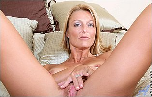 Hot mature blonde Brenda James strips her sexy dress and sensually touches her pussy