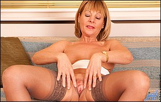 Mature blonde Elaine in sexy panties, nylons and heels showing off her pink pussy