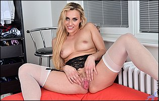 Brittany Bardot in white nylons and black high heels showing off her pink twat
