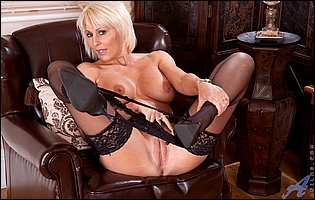 Gorgeous mature blonde Jan Burton in black stockings and heels loves showing her body