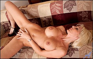 Hot mature lady Jan Burton sensually touches herself