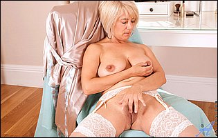 Sexy mature lady Dana in white nylons teasing with hot body