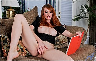 Hot MILF redhead Holly Jane strips and masturbates on couch