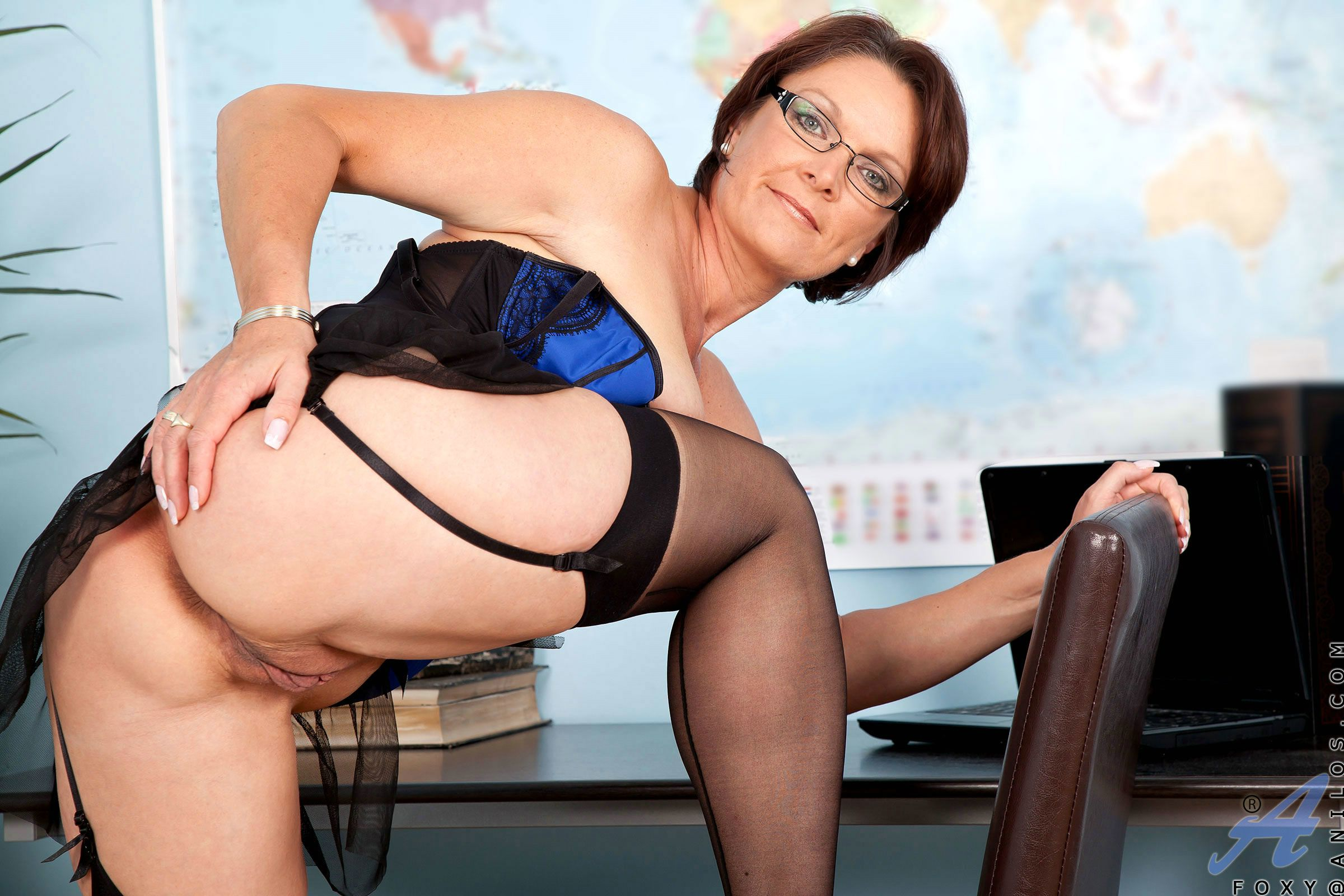 Mature lady Foxy in sexy lingerie, stockings and high heels loves teasing