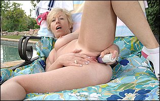 Hot mature blonde Chanel playing with her favorite dildo outdoor