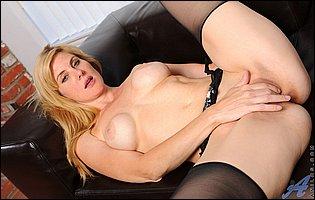 Kate Kastle in sexy black lingerie and stockings loves teasing