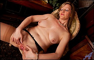 Mature blonde Louise Pearce in nylons and black high heels loves showing her body