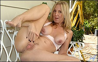 Gorgeous mature blonde Jenna Covelli sensually touches her pussy outdoor