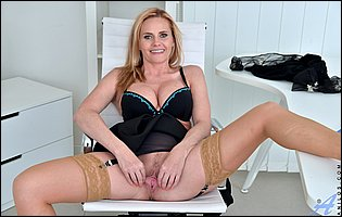 Lili Peterson in sexy lingerie, stockings and heels posing at the office