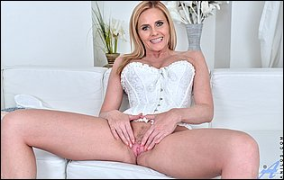 Hot mature blonde Lili Peterson in white corset and heels loves teasing