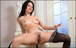 Magda strips off her lingerie and black stockings and touches her pussy