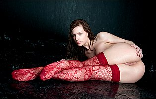 Giselle A in sexy red stockings presents her body