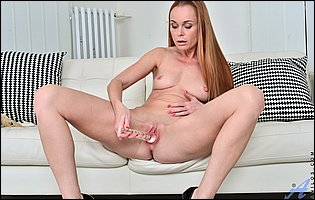 Sexy MILF Nica teasing with tight body and playing with a glass dildo