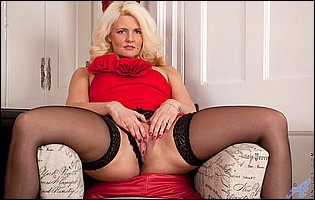 Olivia Jayne in red dress, black stockings and heels stripping and teasing