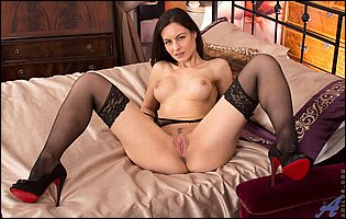 Michelle Khan in black stockings and high heels spreads her pussy
