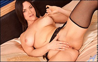 Busty brunette Rebekah Dee in black stockings sensually touches herself