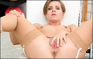 Sasha Zima in sexy stockings sensually touches her pink pussy