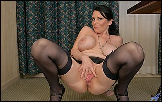 Stacy Ray in black stockings spreading her pink pussy