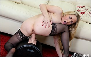 Lusty blonde Aiden Starr in black stockings riding a sybian